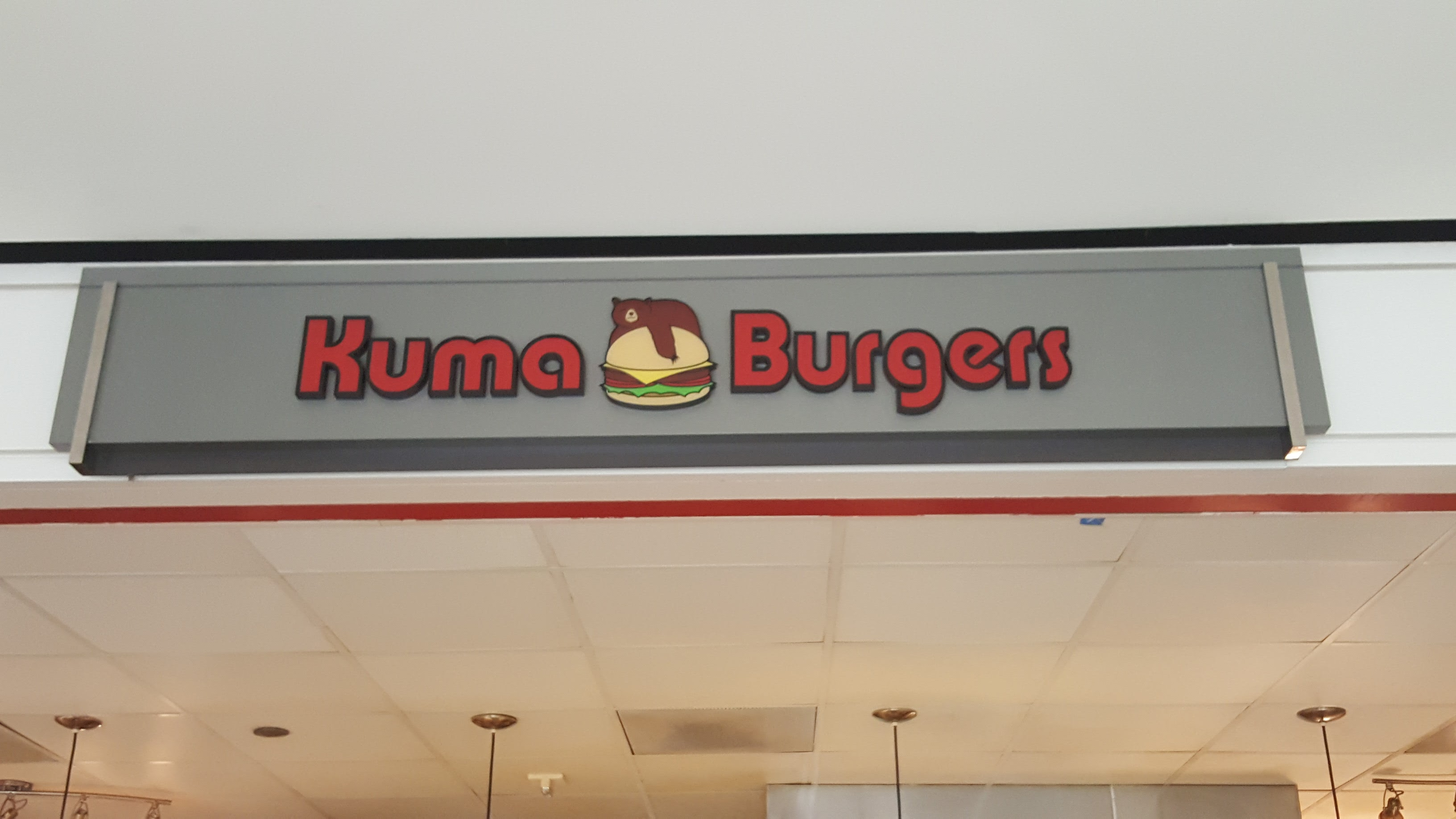 Come on over to greenway plaza for a kuma burger for Cuisine yousra